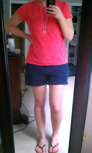 Orange lace shirt, navy shorts outfit