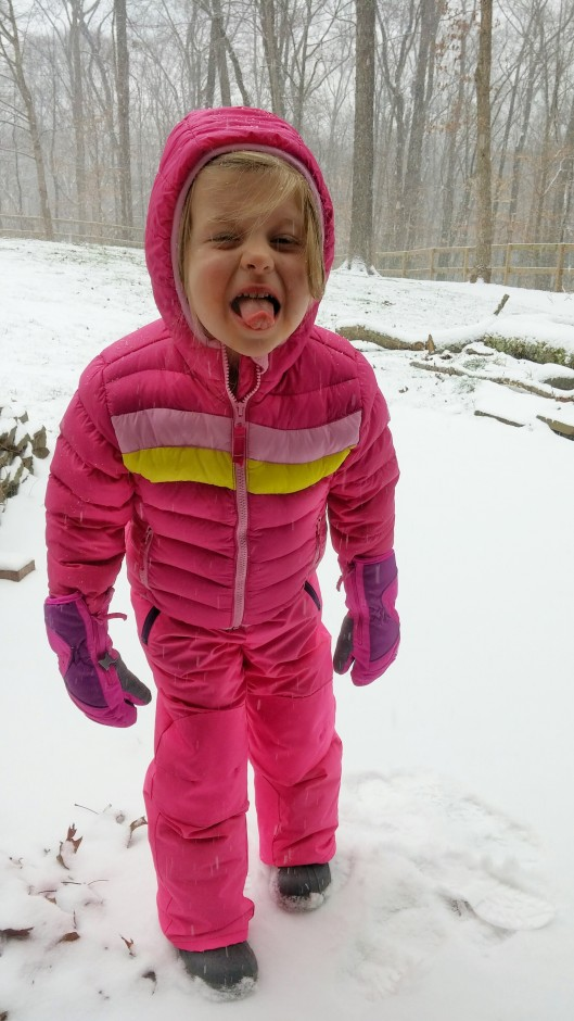 Trying to catch snowflakes and full of hope that they will taste like sugar.